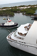 Luxury Cruise Liner enters a Caribbean harbour tugboat assists with piloting the vessel