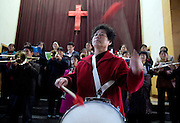 A band practices at the beginning of a Christian church service in Pucheng, Shanxi.