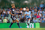 SYDNEY, AUSTRALIA - APRIL 06: Sydney FC defender Michael Zullo (7) kicks the ball past Melbourne Victory midfielder Keisuke Honda (4) at round 24 of the Hyundai A-League Soccer between Sydney FC and Melbourne Victory on April 06, 2019, at The Sydney Cricket Ground in Sydney, Australia. (Photo by Speed Media/Icon Sportswire)