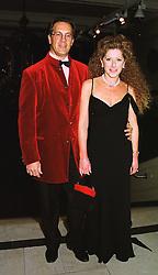 Interior designer KELLY HOPPEN and her husband MR EDWARD MILLER,  at a dinner in London on 20th November 1998.MMG 10