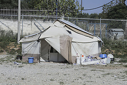 September 22, 2016 - Idomeni, Greece - Daily life inside Diavata UNHCR refugee camp in Northern Greece on 22 September 2016. Diavata Refugee camp is a former military camp ( Anagnostopoulou camp) that was not in use. Now it hosts more than 1000 refugees. In the peaking time it held 4500 people. It is run by UNHCR, IRC (ngo) and the greek army, under the supervision of the Migration ministry. Refugees are blocked in Greece. They don't want to stay here but to continue their trip to central and northern Europe. Many of them mention the welfare privilages. Others complaint about the living conditions and that they are not allowed to work in Greece in contrast with Turkey that they were working for a few pennies. Most of the people here are from Syria, Afghanistan, Iran and Iraq. This camp has a high concentration of minors. (Credit Image: © Nicolas Economou/NurPhoto via ZUMA Press)