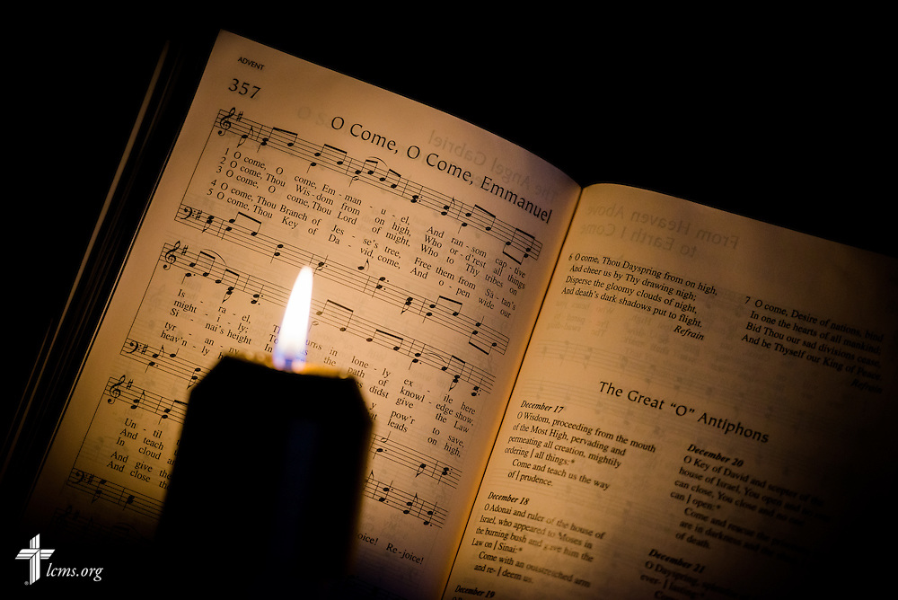 The Lutheran Service Book is lit by candlelight at The Lutheran Church--Missouri Synod International Center in Kirkwood, Mo.,  on Thursday, Dec. 19, 2013. LCMS Communications/Erik M. Lunsford