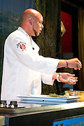 Chef Darrly Harmon, Executive Chef at the Water Works in Philadelphia, demonstrates how to prepare various cuts of steak at the Grand Market during the Atlantic City Food & Wine Festival. Chef Harmon is assisted by Chef Barry Sexton of The Opinionated Palate Catering.