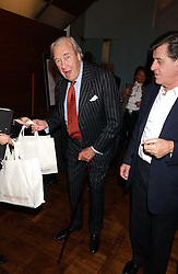 Left to right, BRUCE SHAND and his son in law SIMON ELLIOT at a party to celebrate the publication of 'E is for Eating' by Tom Parker Bowles held at Kensington Place, 201 Kensington Church Street, London W8 on 3rd November 2004.<br />