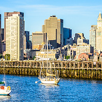 Boston skyline panoramic picture with Boston Harbor, downtown Boston skyscrapers, Port of Boston pier and sailboats. Panorama photo ratio is 1:3.