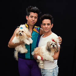 Portrait of Jose Aston Neves and his partner Andrei Ricardo Peixotode Oliveira with their dogs. The couple work as a dancer and trapeze flier respectively.<br />