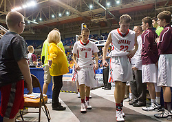 Bridgeport players react after losing to Fairmont Senior during a semi-final game at the Charleston Civic Center.