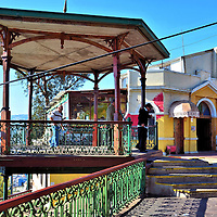 Upper Station Gazebo of Ascensor Artillería in Valparaíso, Chile<br /> A must-do experience while vacationing in Valparaíso is riding a funicular.  One of the best is Ascensor Artillería.  Built next to an earlier elevator in 1908, the lift's 574 foot assent takes only 80 seconds to reach this station at the top of Artillería Hill.  The ride is fun, the views of the city and harbor from Paseo 21 de Mayo terrace are terrific and the Playa Ancha neighborhood is interesting to explore, especially the nearby National Maritime Museum.