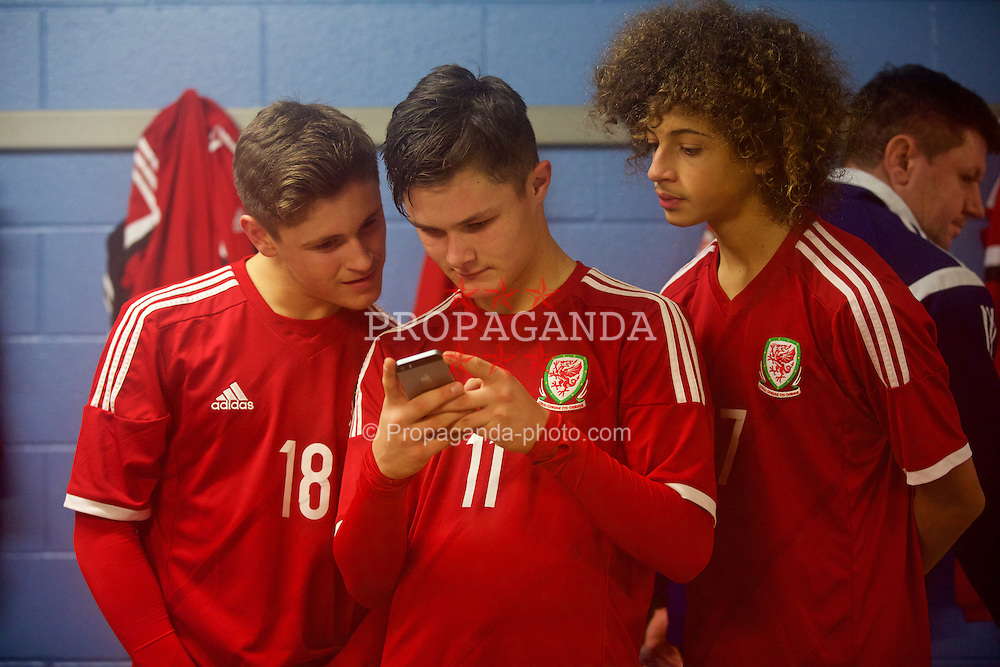 BALLYMENA, NORTHERN IRELAND - Thursday, November 20, 2014: Wales' Keiran Evans, Liam Cullen and Ethan Ampadu in the dressing room after beating Northern Ireland 2-0 during the Under-16's Victory Shield International match at the Ballymena Showgrounds. (Pic by David Rawcliffe/Propaganda)