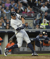 October 18, 2017 - Bronx, NY, USA - The New York Yankees' Aaron Judge hits an RBI double in the third inning against the Houston Astros in Game 5 of the American League Championship Series at Yankee Stadium in New York on Wednesday, Oct. 18, 2017. (Credit Image: © Howard Simmons/TNS via ZUMA Wire)