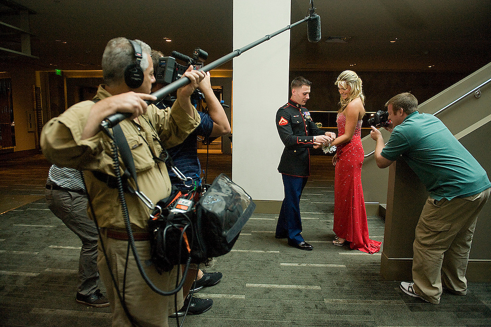 FRIDAY MAY 18, 2012, FORT LAUDERDALE, FL - LPGA golfer Lexi Thompson receives a corsage from US Marine LCpl Mark Scott while their are filmed by a Red Bull crew at  The W in Fort Lauderdale, FL. Thompson held a contest for US servicemen to take her to prom. Scott won the contest and took her on a date before the prom. PHOTO BY JOSH RITCHIE