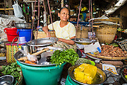 14 JUNE 2013 -  PATHEIN, AYEYARWADY, MYANMAR: A vendor in the market in Pathein, Myanmar. Pathein, sometimes also called Bassein, is a port city and the capital of the Ayeyarwady Region, Burma. It lies on the Pathein River (Bassein), which is a western branch of the Irrawaddy River. It's the fourth largest city in Myanmar (Burma) about 190 km west of Yangon.   PHOTO BY JACK KURTZ