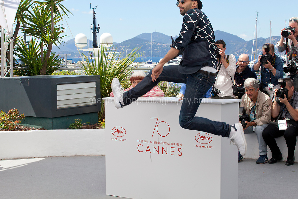 Photographer and Director JR and director Agnès Varda<br /> at the Visages, Villages film photo call at the 70th Cannes Film Festival Friday 19th May 2017, Cannes, France. Photo credit: Doreen Kennedy