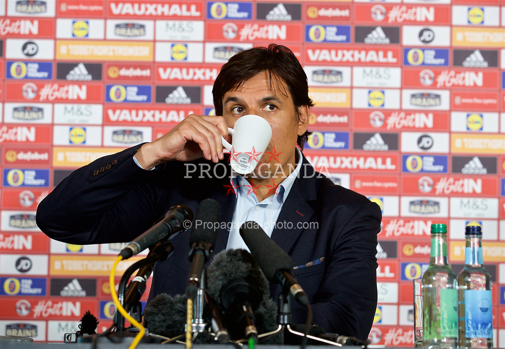 CARDIFF, WALES - Thursday, May 25, 2017: Wales' Wales manager Chris Coleman sips from a cup of coffee at the Vale Resort during a press conference to announce his squad ahead of the 2018 FIFA World Cup Qualifying Group D match against Serbia. (Pic by David Rawcliffe/Propaganda)