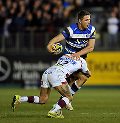 Sam Burgess of Bath Rugby is tackled by Sam Tuitupou of Sale Sharks - Photo mandatory by-line: Patrick Khachfe/JMP - Mobile: 07966 386802 06/03/2015 - SPORT - RUGBY UNION - Bath - The Recreation Ground - Bath Rugby v Sale Sharks - Aviva Premiership