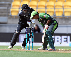 Pakistan's Sarfraz Ahmed plays in front of New Zealand's Glenn Phillips in the first T20 International Cricket match, Westpac Stadium, Wellington, New Zealand, Monday, January 22, 2018