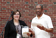 Alexis Larsen (left) and Clifford Darrett announce door prize winners during Vectren's Jazz & Beyond at the Dayton Art Institute, Thursday, May 3, 2012.