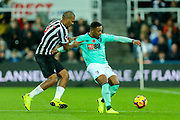 Jordon Ibe (#10) of Bournemouth controls the ball under pressure from Jose Salomon Rondon (#9) of Newcastle United during the Premier League match between Newcastle United and Bournemouth at St. James's Park, Newcastle, England on 10 November 2018.
