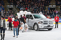 KELOWNA, CANADA - DECEMBER 6: Volunteers load a Dodge Ram pick up truck with teddy bears after the first annual Teddy Bear Toss at the Kelowna Rockets on December 6, 2013 at Prospera Place in Kelowna, British Columbia, Canada.   (Photo by Marissa Baecker/Shoot the Breeze)  ***  Local Caption  ***