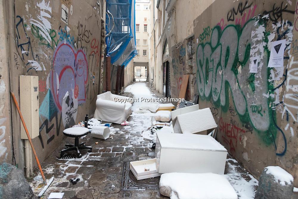 France. Paris. 4th district. graffitis and garbages rue vielle du temple, in passage d Argensson