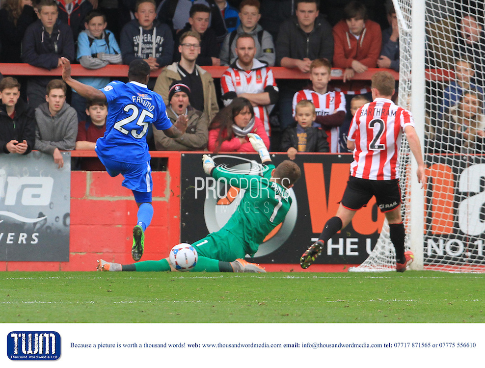 Dillon Phillips  saves Matty Fanimo's shot during the Vanarama National League match between Cheltenham Town and Eastleigh at Whaddon Road, Cheltenham, England on 17 October 2015. Photo by Antony Thompson.