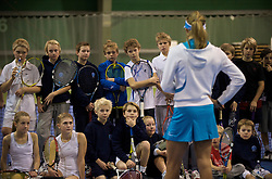 OSLO, NORWAY - Saturday, December 19, 2009: Yanina Wickmayer gives advice to the kids during the Northern Vision Tennis Academy at the Riksanlegget. (Pic by David Rawcliffe/Propaganda)