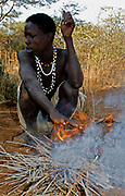 Hadzabe hunter at his fireplace. Lake Eyasi, northern Tanzania.