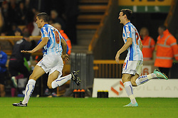 Huddersfield Town's Conor Coady celebrates his goal and his sides third goal making it 0 - 3 - Photo mandatory by-line: Dougie Allward/JMP - Mobile: 07966 386802 - 01/10/2014 - SPORT - Football - Wolverhampton - Molineux Stadium - Wolverhampton Wonderers v Huddersfield Town - Sky Bet Championship