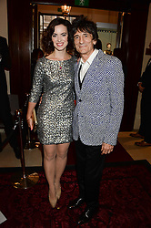 RONNIE WOOD and his wife SALLY HUMPHREYS at the GQ Men of The Year Awards 2013 in association with Hugo Boss held at the Royal Opera House, London on 3rd September 2013.
