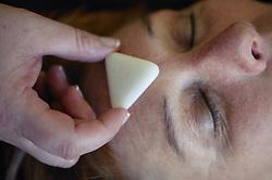 Patient having La Stone Therapy,