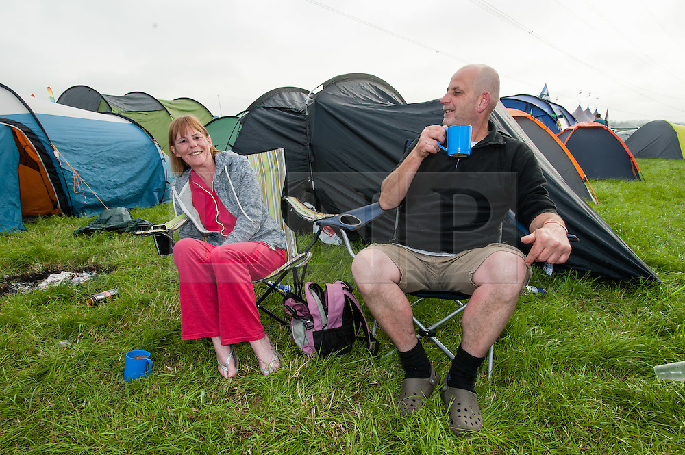 © Licensed to London News Pictures. 25/06/2015. Pilton, UK. Festival campsite atmosphere at Glastonbury Festival 2015 on Thursday Day 2 of the festival.  This years headline acts include Kanye West, The Who and Florence and the Machine, the latter having been upgraded in the bill to replace original headline act Foo Fighters.   Photo credit: Richard Isaac/LNP