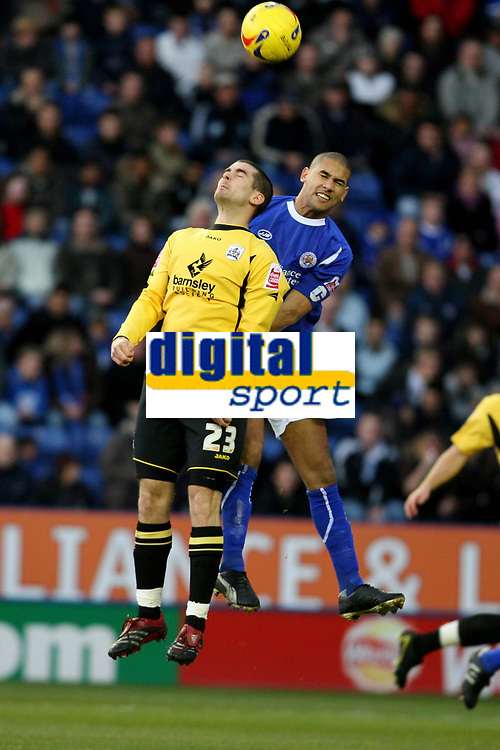 Photo: Pete Lorence.<br />Leicester City v Barnsley. Coca Cola Championship. 16/12/2006.<br />Daniel Nardiello and Patrick Kisnorbo battle for the ball.