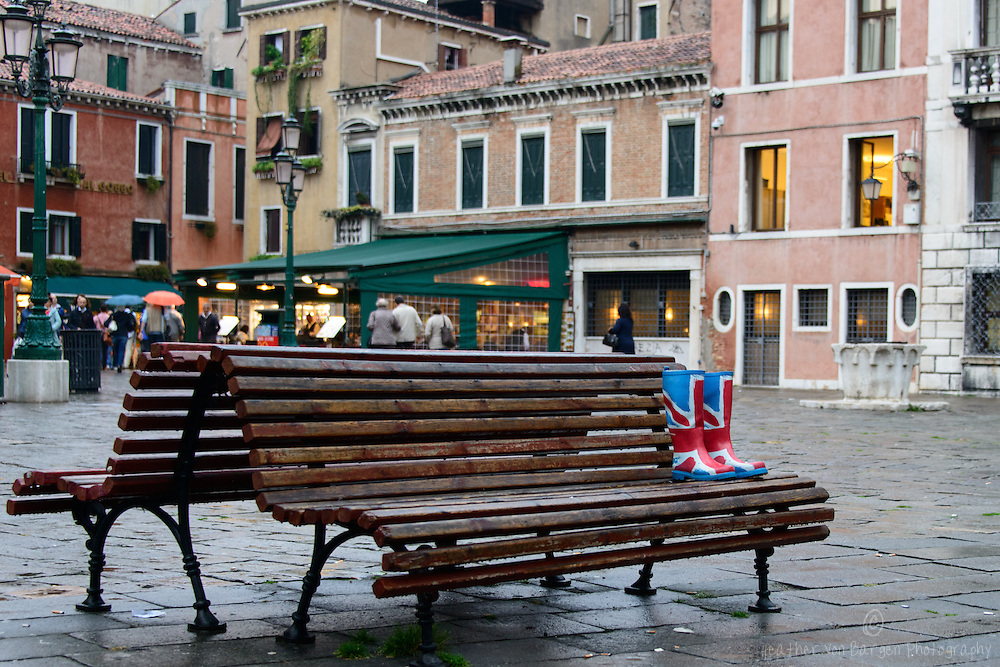 Rain boots on a bench in Venice