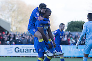 AFC Wimbledon striker Tom Elliott (9) scores a goal 2-2 and celebrates with AFC Wimbledon defender George Francomb (7) during the EFL Sky Bet League 1 match between AFC Wimbledon and Millwall at the Cherry Red Records Stadium, Kingston, England on 2 January 2017. Photo by Stuart Butcher.
