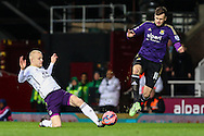 Carl Jenkinson of West Ham United (right) is beaten to the ball by Steven Naismith of Everton (left) during the FA Cup match at the Boleyn Ground, London<br /> Picture by David Horn/Focus Images Ltd +44 7545 970036<br /> 13/01/2015