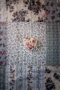 a heart with roses on a vintage plaid