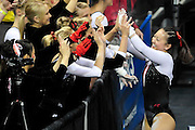 Corrie Lothrop celebrates with her team after her routine on the uneven parallel bars at the 2011 Women's NCAA Gymnastics Semifinals on April 15, in Cleveland, OH. (photo/Jason Miller)