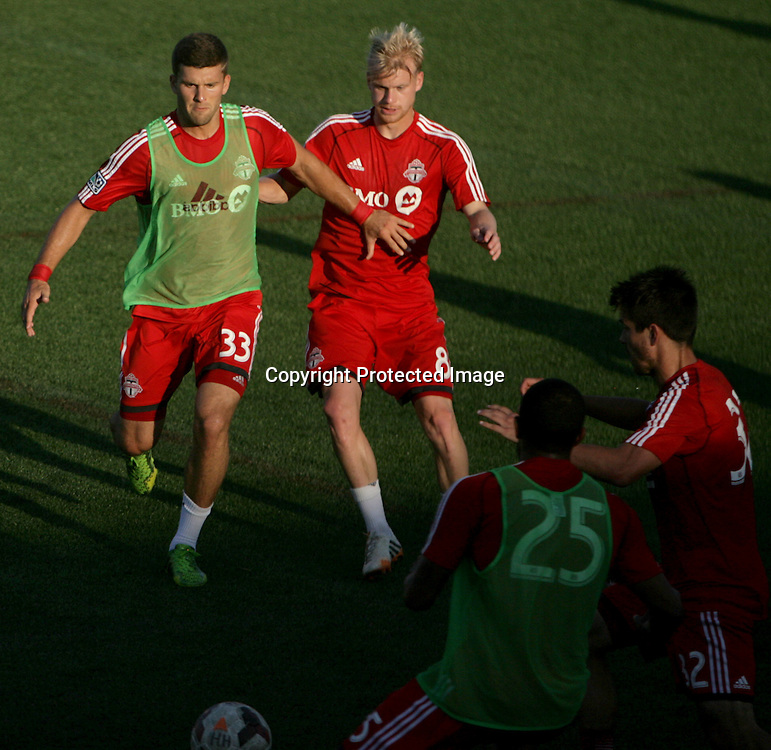 Members of Toronto FC warm up before a friendly against Wilmington Hammerheads FC Wednesday June 18, 2014 at Legion Stadium in Wilmington, N.C. (Jason A. Frizzelle)