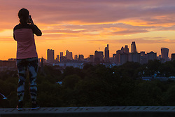 Primrose Hill, London, September 27th 2016. A man photographs the glorious sunrise on Primrose Hill as dawn breaks over London. ©Paul Davey<br /> FOR LICENCING CONTACT: Paul Davey +44 (0) 7966 016 296 paul@pauldaveycreative.co.uk