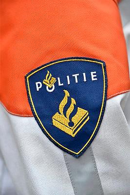 Nederland, Nijmegen, 19-11-2014Politieman met embleem van de politie op zijn uniform.Foto: Flip Franssen/Hollandse Hoogte