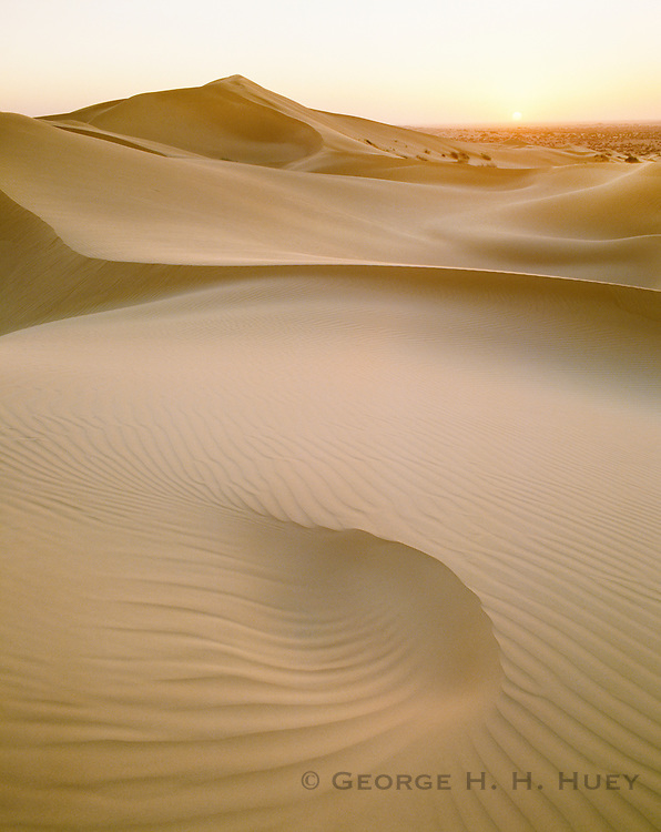 6101-1004 ~ Copyright:  George H. H. Huey ~ Sun setting over sand dunes in the Pinacate Reserve.  Sonora, Mexico.