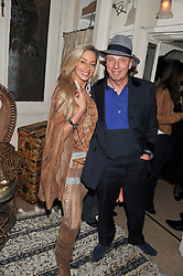 SARA HERSHAM LOFTUS and SIMON WOODROFFE at a party to celebrate the publication of Seductive Interiors by Sara Hersham Loftus at Julie's, 135 Portland Road, London W11 on 15th November 2012.