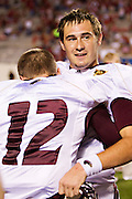 LITTLE ROCK, AR - SEPTEMBER 8:   Kolton Browning #15 is hugged by Brayle Brown #12 of the Louisiana-Monroe Warhawks after a game against the  Arkansas Razorbacks at War Memorial Stadium on September 8, 2012 in Little Rock, Arkansas.  The Warhawks defeated the Razorbacks 34-31.  (Photo by Wesley Hitt/Getty Images) *** Local Caption *** Kolton Browning