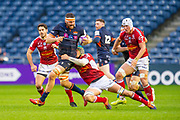 Nick Haining (#8) of Edinburgh Rugby is tackled by Jessy Jegerlhener (#7) of SU Agen Rugby during the European Rugby Challenge Cup match between Edinburgh Rugby and SU Agen at BT Murrayfield, Edinburgh, Scotland on 18 January 2020.
