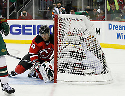 Mar 20, 2009; Newark, NJ, USA; New Jersey Devils right wing Brian Gionta (14) shoots the puck by Minnesota Wild goalie Niklas Backstrom (32) during the second period at the Prudential Center.