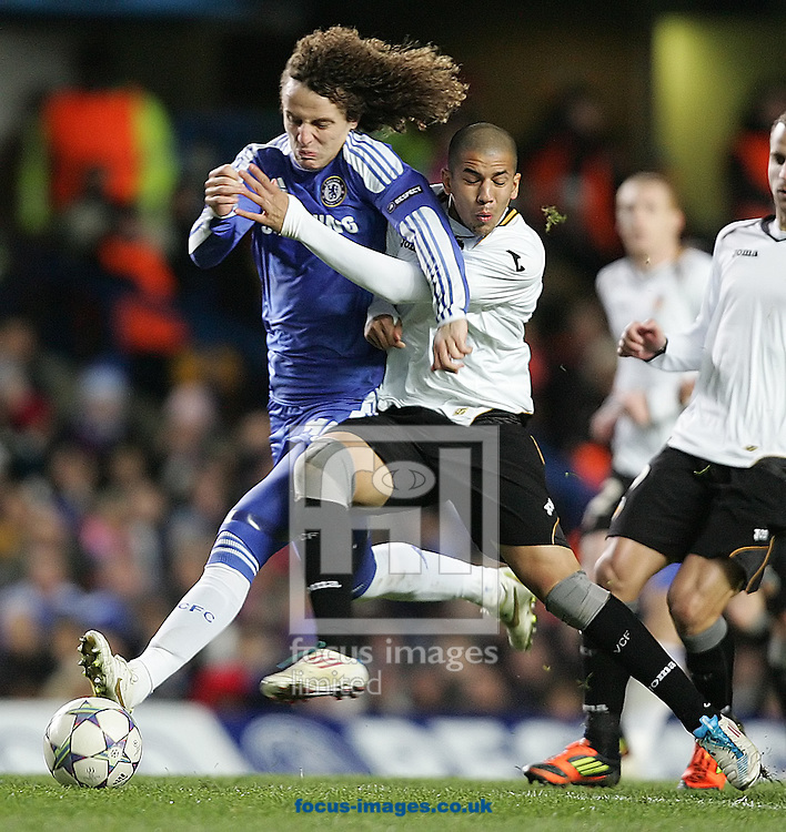 Picture by Paul Terry/Focus Images Ltd. 07545642257.6/12/11.David Luiz of Chelsea and Sofiane Feghouli of Valencia during the UEFA Champions League match at Stamford Bridge stadium, London.