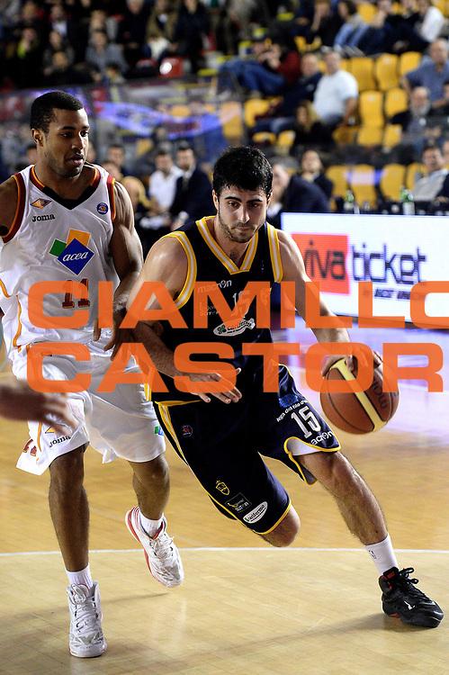 DESCRIZIONE : Roma Lega serie A 2013/14 Acea Virtus Roma Sutor Montegranaro<br /> GIOCATORE : Nemanja Mitrovic<br /> CATEGORIA : palleggio<br /> SQUADRA : Sutor Montegranaro<br /> EVENTO : Campionato Lega Serie A 2013-2014<br /> GARA : Acea Virtus Roma Sutor Montegranaro<br /> DATA : 18/01/2014<br /> SPORT : Pallacanestro<br /> AUTORE : Agenzia Ciamillo-Castoria/M.Greco<br /> Fotonotizia : Roma Lega serie A 2013/14 Acea Virtus Roma Sutor Montegranaro<br /> Predefinita :