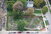 The North Cass Community Garden sits where three blighted buildings once stood. The garden, covering .37 acres, offers over 75 raised plots to the surrounding residents and businesses.