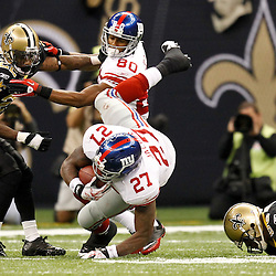 November 28, 2011; New Orleans, LA, USA; New Orleans Saints linebacker Jo-Lonn Dunbar (56) trips up New York Giants running back Brandon Jacobs (27) during the third quarter of a game at the Mercedes-Benz Superdome. The Saints defeated the Giants 49-24. Mandatory Credit: Derick E. Hingle-US PRESSWIRE