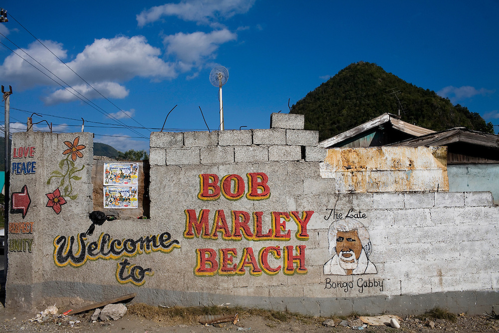 """A sign for """"Bob Marley Beach"""" on the road from Kingston to the Geejam Hotel in Portland.  The Geejam is a luxury boutique hotel with a state of the art recording studio that has attracted famous musicians to make their albums."""